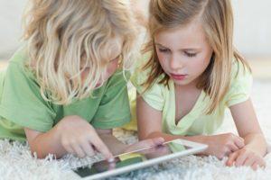 children-playing-with-ipad-jpg-ashx